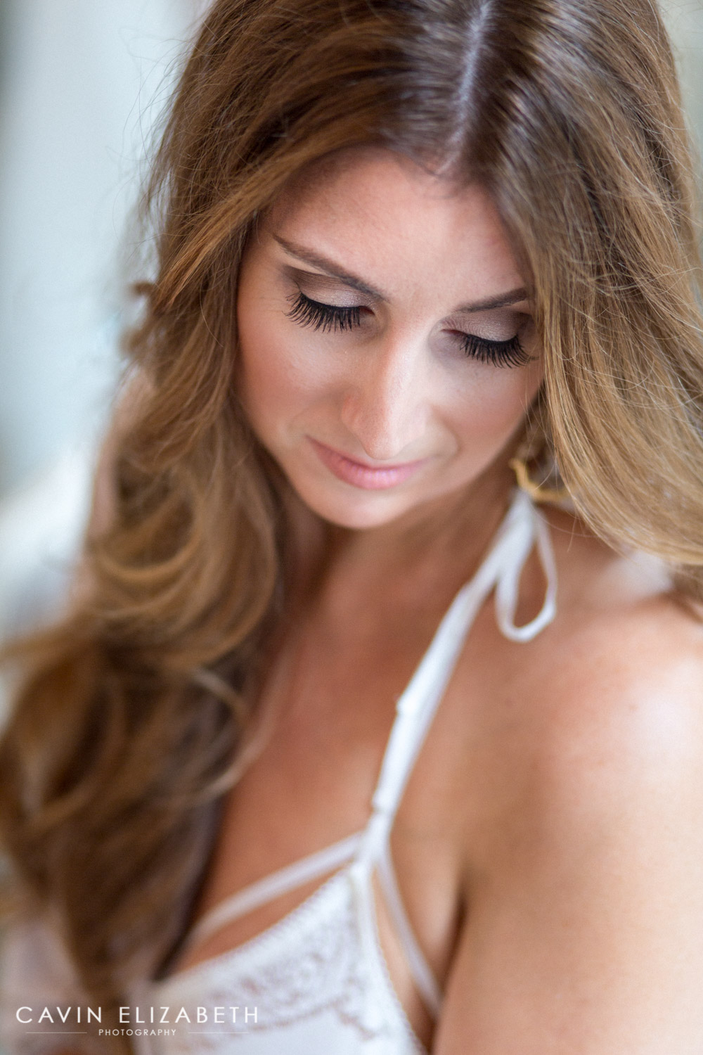 bride to be wears gorgeous white bra for boudoir shoot with cavin elizabeth photography in san diego