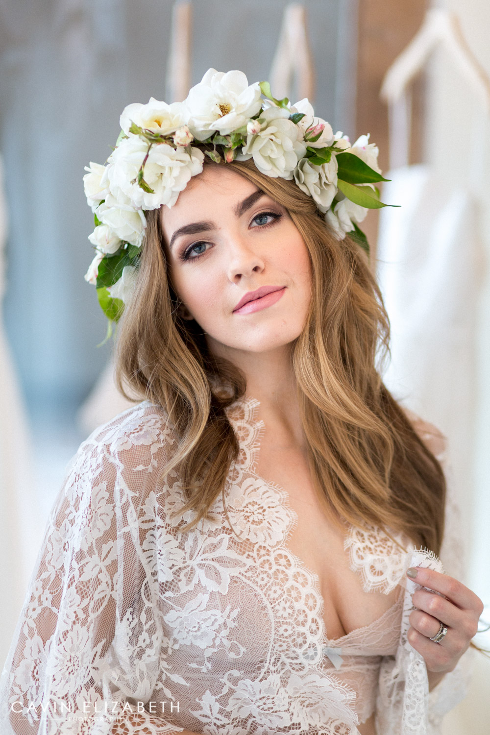 bride to be wears siren floral co flower crown and white lace robe for boudoir shoot with cavin elizabeth photography