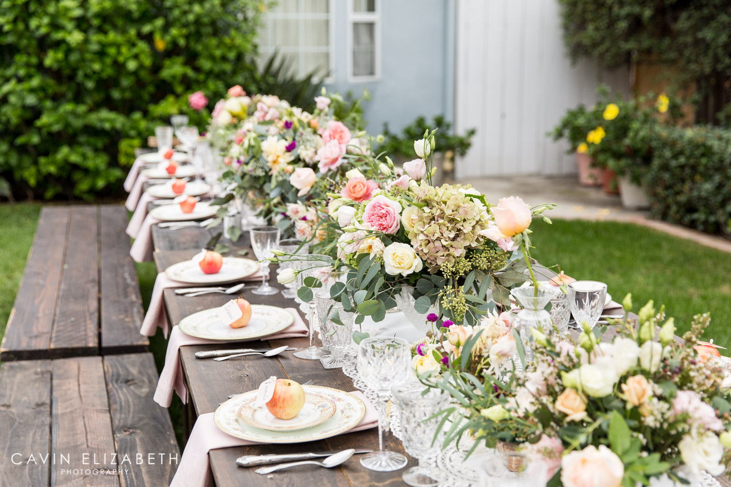 apple place cards for an outdoor bridal shower in san diego with a floral runner