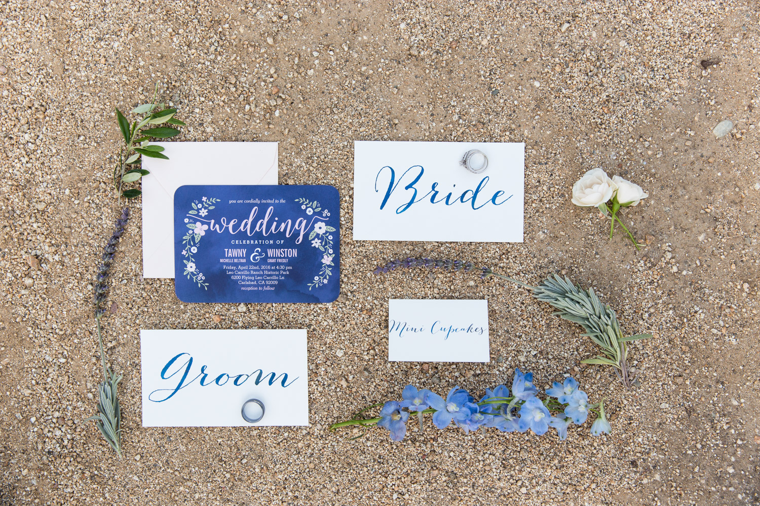 Navy blue and white wedding invitation suite with bride and groom calligraphy cards