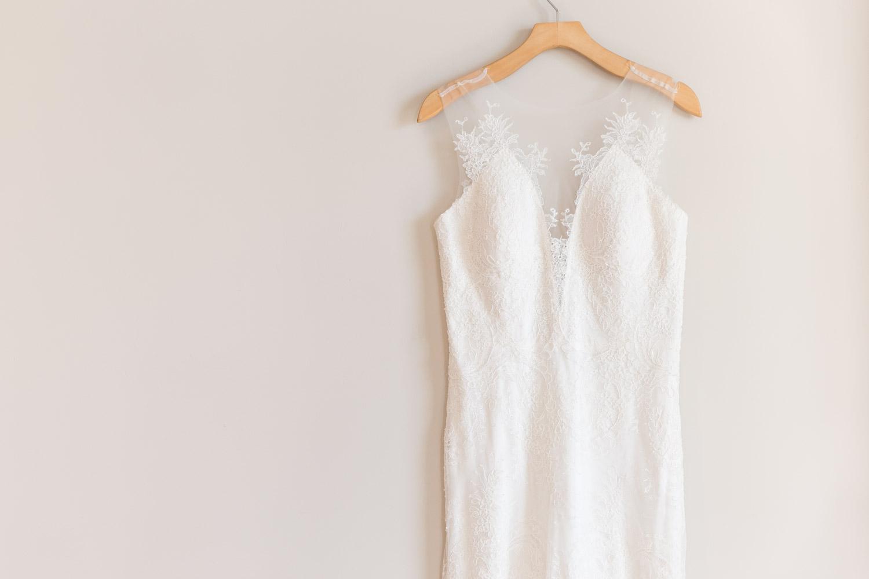 Gorgeous sleeveless illusion sleeve neckline wedding gown from Elle Bridal Boutique