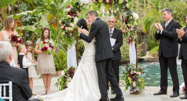 First kiss at the altar at a Jones Victorian Estate Wedding in Orange County by Cavin Elizabeth