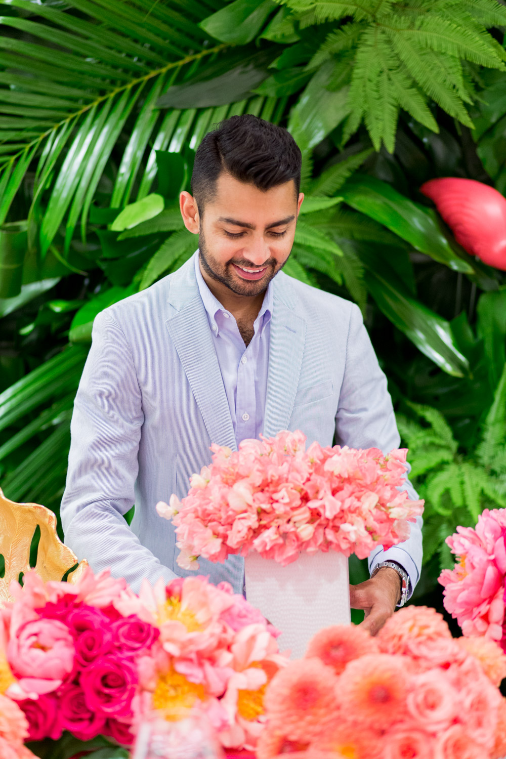 Fayaz from Bloom Box with pink floral arrangements in Orange County