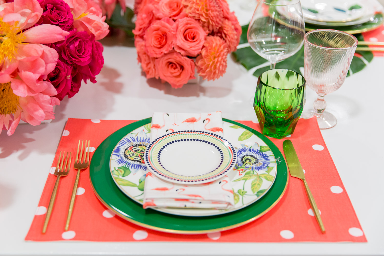 Summery green and blue charger and plate with flamingo napkin and modern green glassware on top of a pink polkadot Kate Spade placemat with Bloom Box Details Details and Cavin Elizabeth Photography