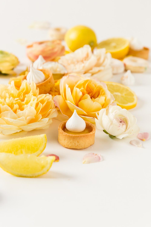 yellow flatlay food photography with lemons passion fruit tarts mini ...
