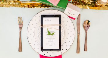 Kate Spade charger and flatware with a paper menu on an acrylic black rectangle, Kate Spade bridal event in San Diego with Couture Events and Cavin Elizabeth Photography