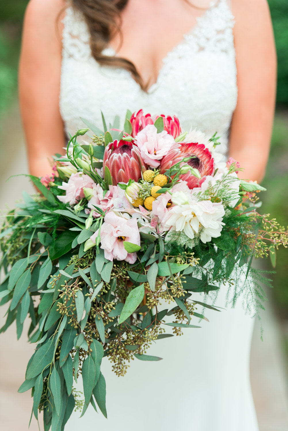 African flower protea pink white and green large bridal bouquet at Desert Ridge Estate, Cavin Elizabeth Photography