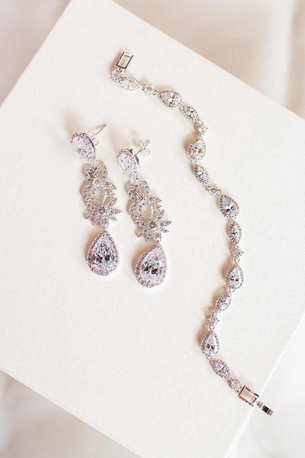 Diamond luxury earrings for a bride on her wedding day and a diamond bracelet, Cavin Elizabeth Photography