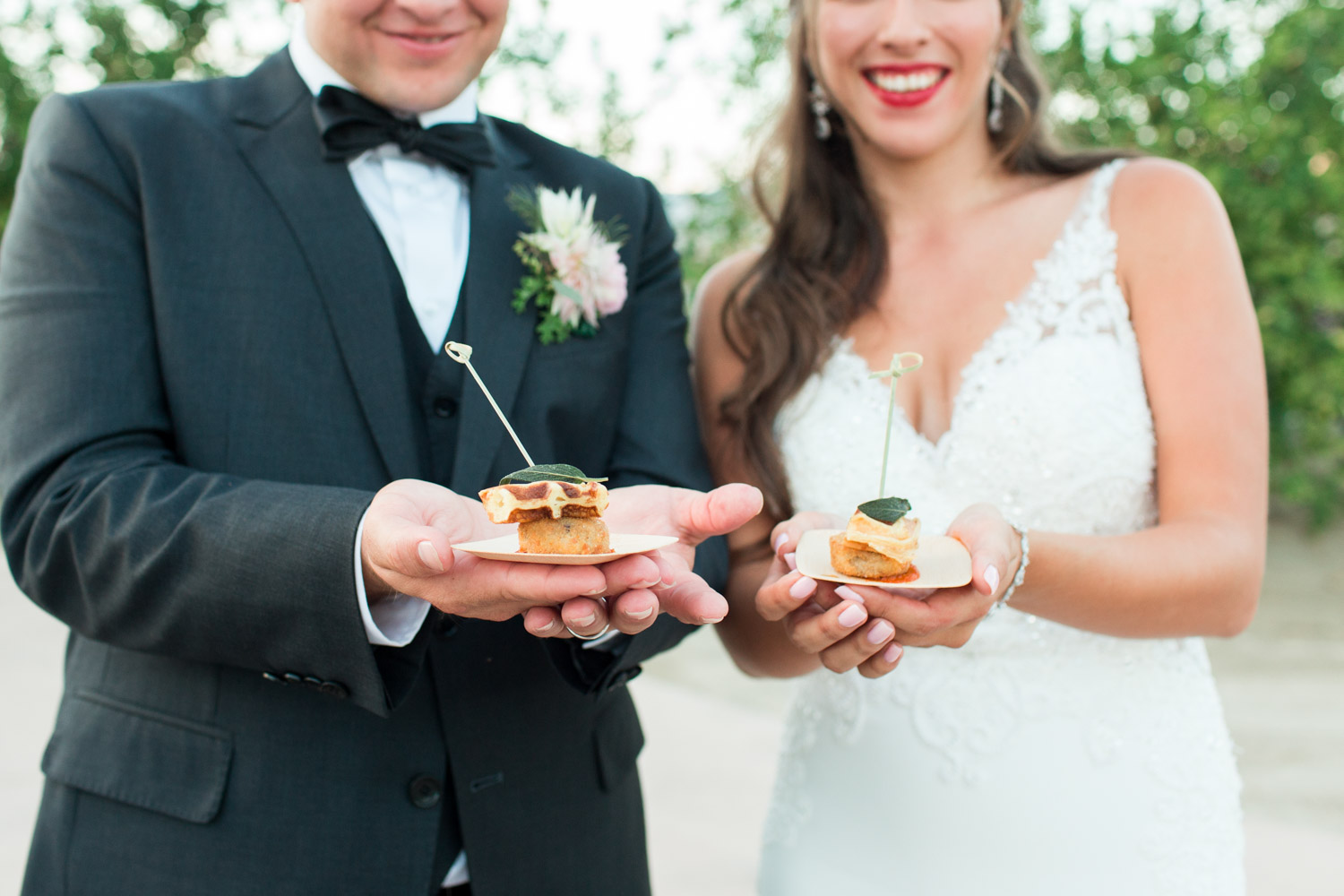 Bride and groom with mini chicken and waffles at their wedding in Palm Springs, Cavin Elizabeth Photography