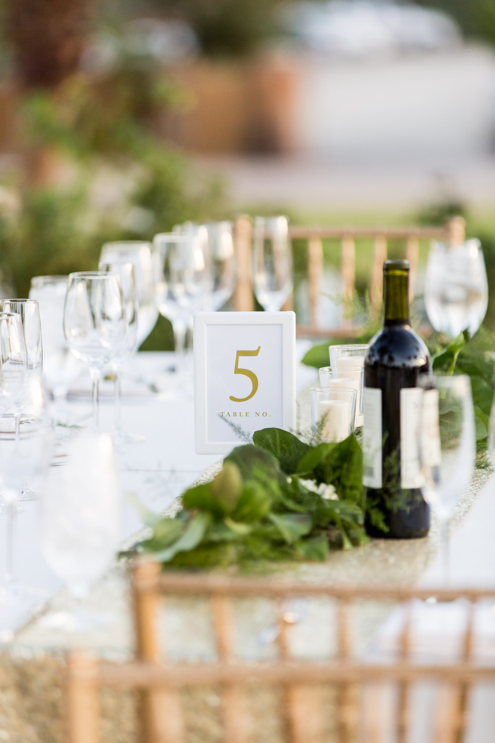 Luxury Palm Desert wedding reception with square and rectangle tables with white rose gold and green decor, Cavin Elizabeth Photography