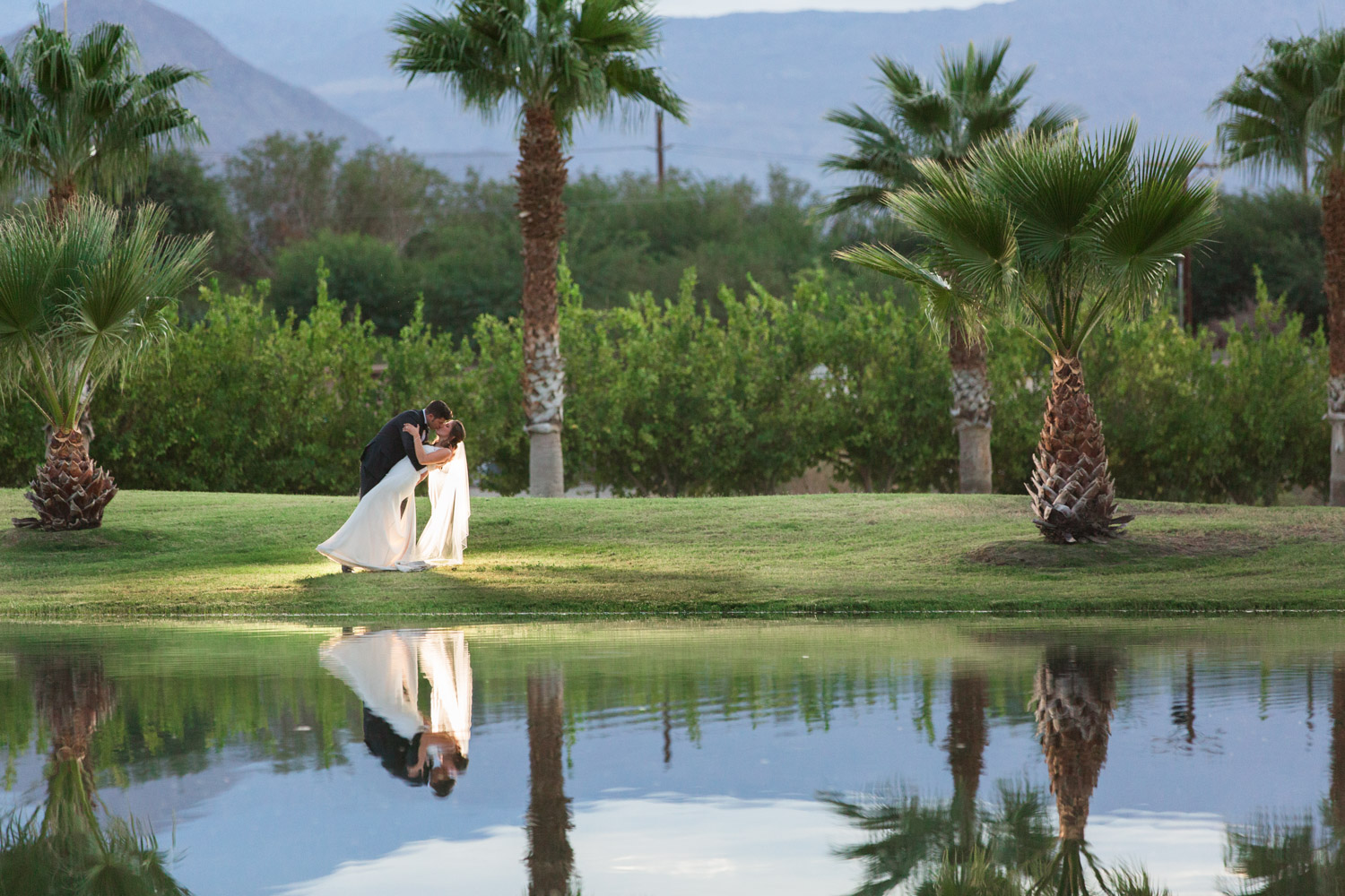 Sunset photo of a bride and groom dancing at Desert Ridge Estate, Cavin Elizabeth Photography