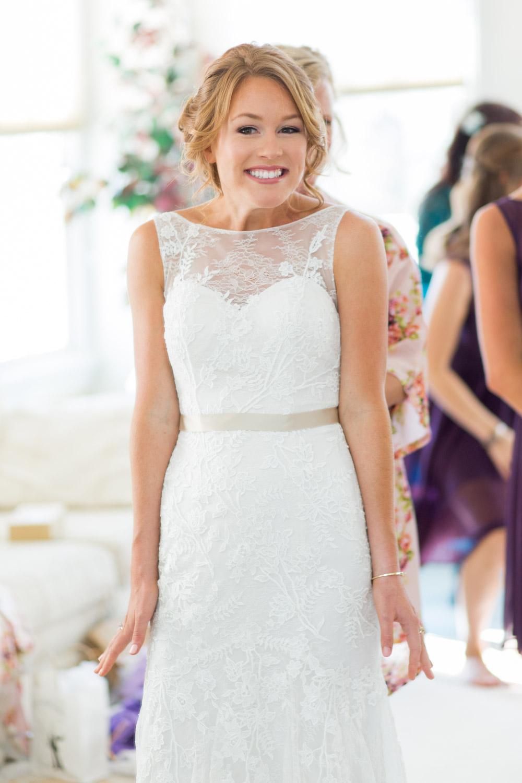 Gorgeous redhead bride getting her sleeveless wedding dress on, Walker's Overlook wedding, Cavin Elizabeth Photography