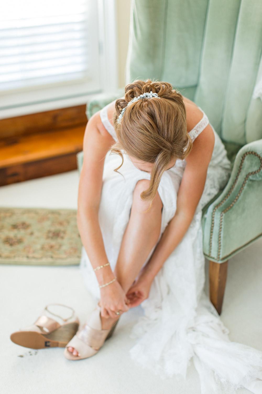 Gorgeous redhead bride getting her wedding shoes on, Walker's Overlook wedding, Cavin Elizabeth Photography