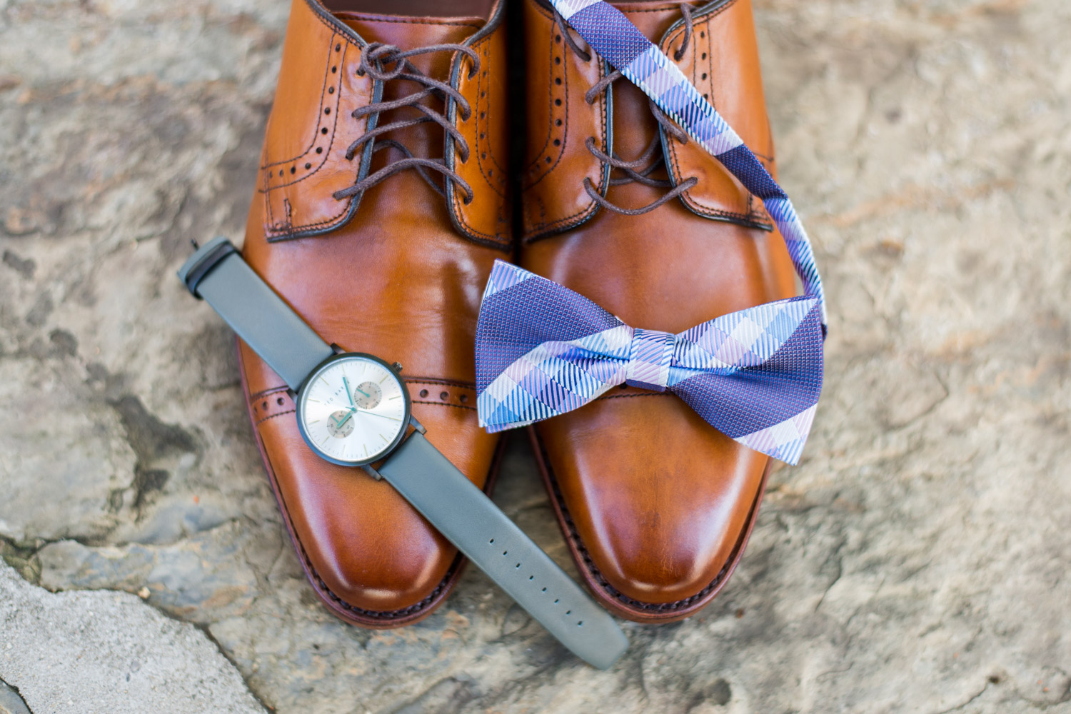 Groom's tan shoes with watch and eggplant and blue bowtie, Cavin Elizabeth Photography