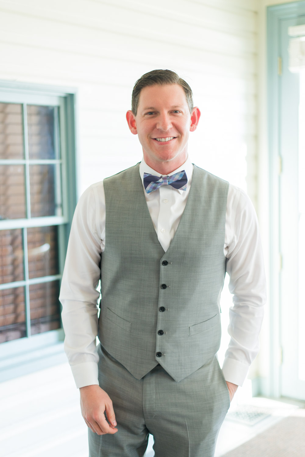 Groom portrait in a gray suit and eggplant and blue bowtie, Cavin Elizabeth Photography