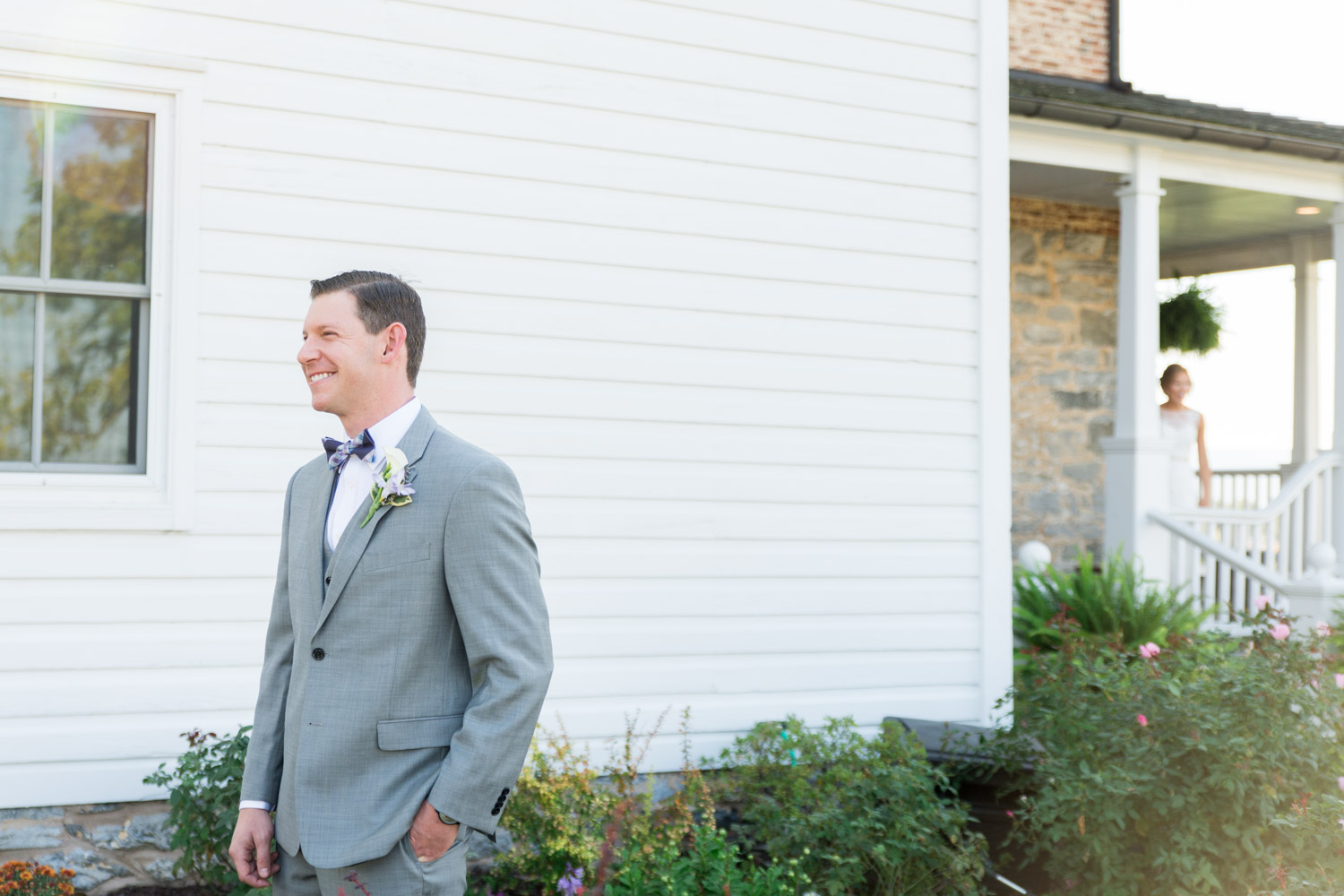 Groom portrait in a gray suit and eggplant and blue bowtie waiting for the bride for the first look, Cavin Elizabeth Photography