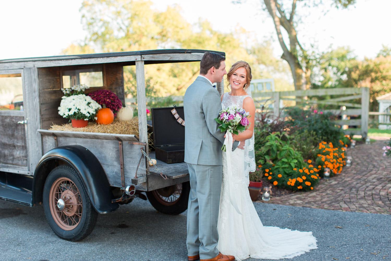 Bride and groom portrait with vintage car