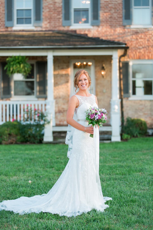 Bridal portrait of a redhead bride in a sleeveless wedding gown with a bridal bouquet, Cavin Elizabeth Photography