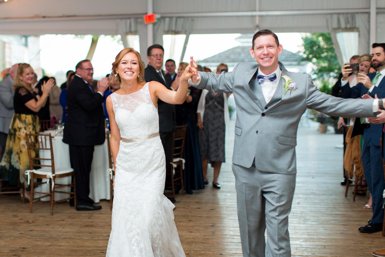 Bride and groom grand entrance at Walker's Overlook tented wedding reception, Cavin ELizabeth Photography