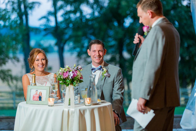 Bride and groom toast reactions at Walker's Overlook tented wedding reception, Cavin ELizabeth Photography