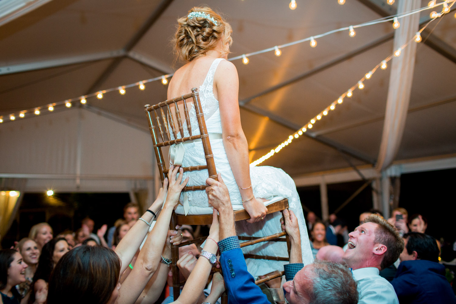 Bride and groom hora on the dance floor at Walker's Overlook, nighttime wedding photography from Cavin Elizabeth Photography