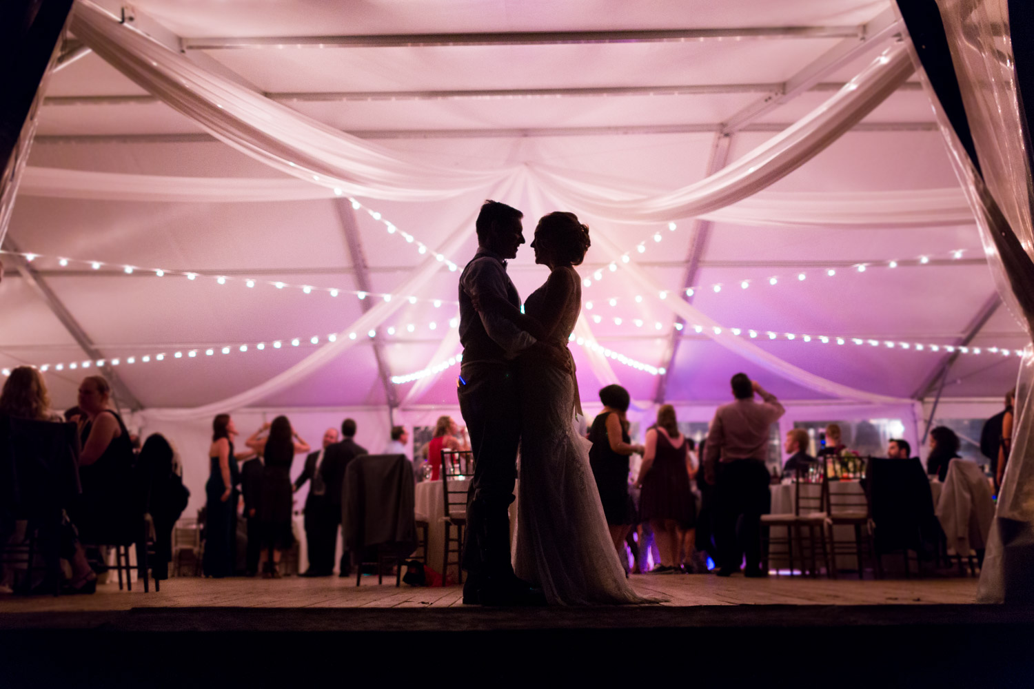 Dramatic nighttime silhouette during wedding reception at Walker's Overlook, Cavin Elizabeth Photography