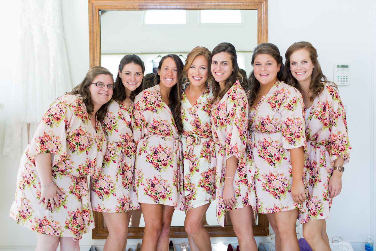 Bridesmaids getting ready for her wedding wearing a cute robe, Cavin Elizabeth Photography