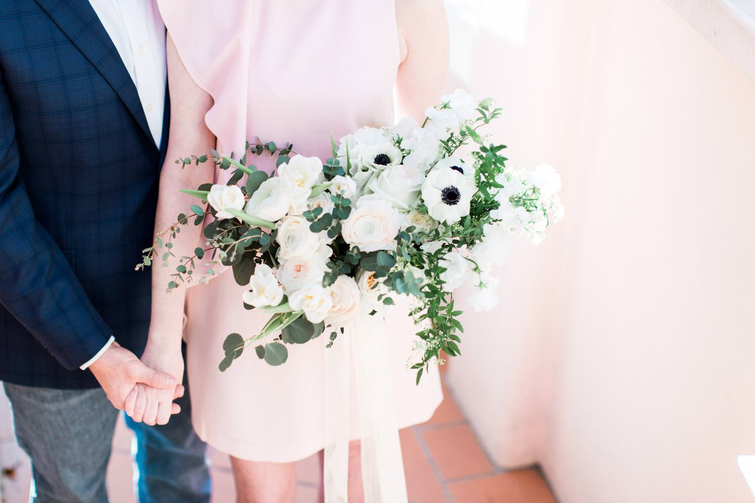 Formal La Valencia Anniversary Photos in La Jolla, Gorgeous white ranuncula and anemone white and green bouquet from Adorations in San Diego, Cavin Elizabeth Photography