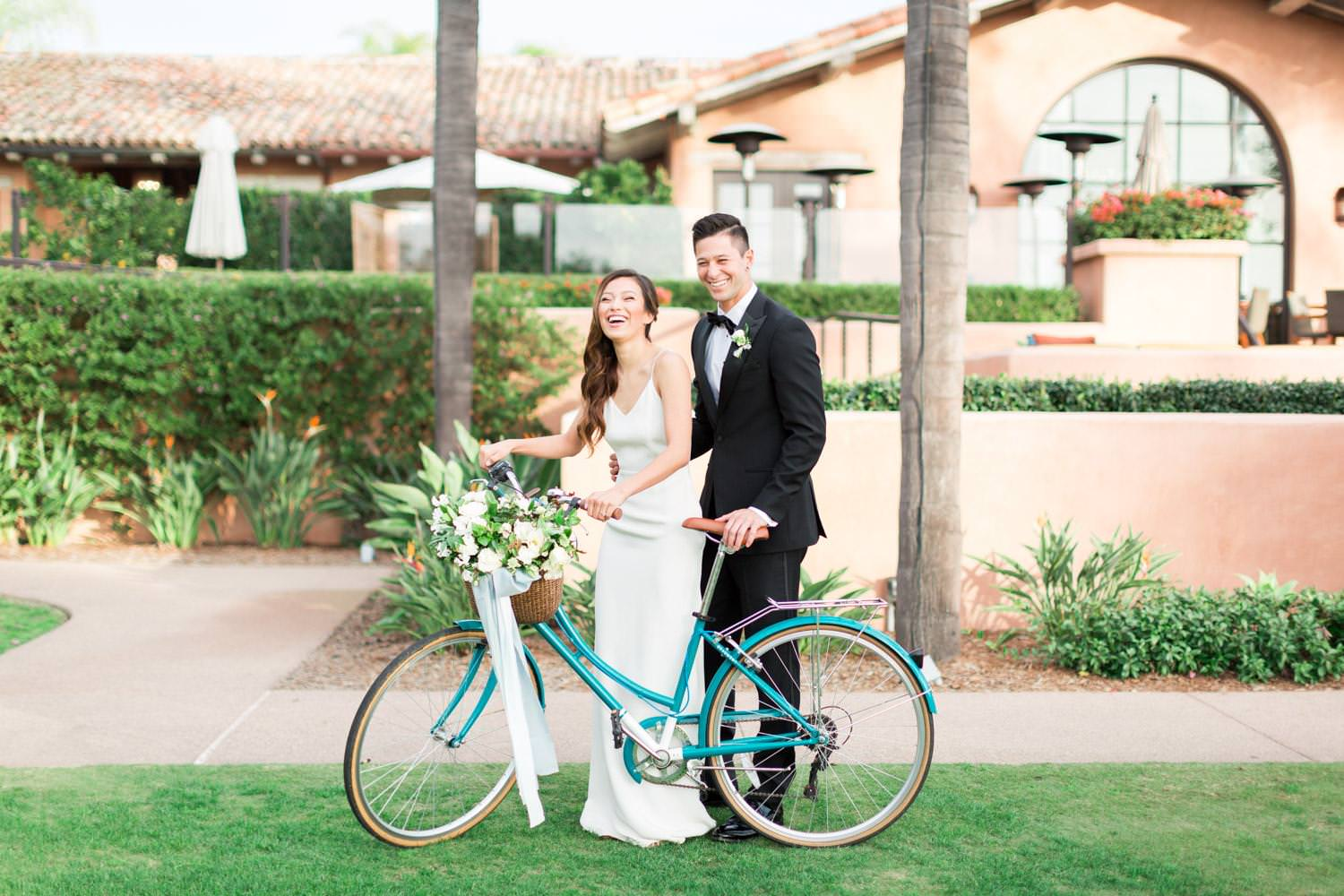 Rancho Valencia Wedding Photography by Cavin Elizabeth, bride and groom with floralized bicycle