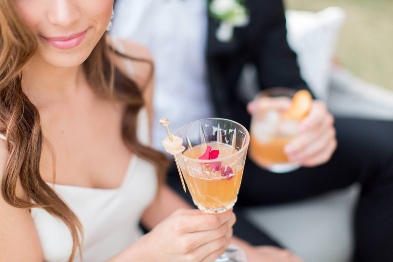 Rancho Valencia Wedding Photography by Cavin Elizabeth, bride and groom drinking specialty wedding cocktails
