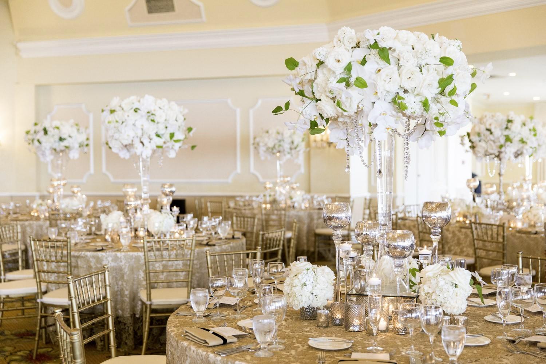 lavish hotel del coronado reception by blush botanicals hotel del coronado grand ballroom wedding with