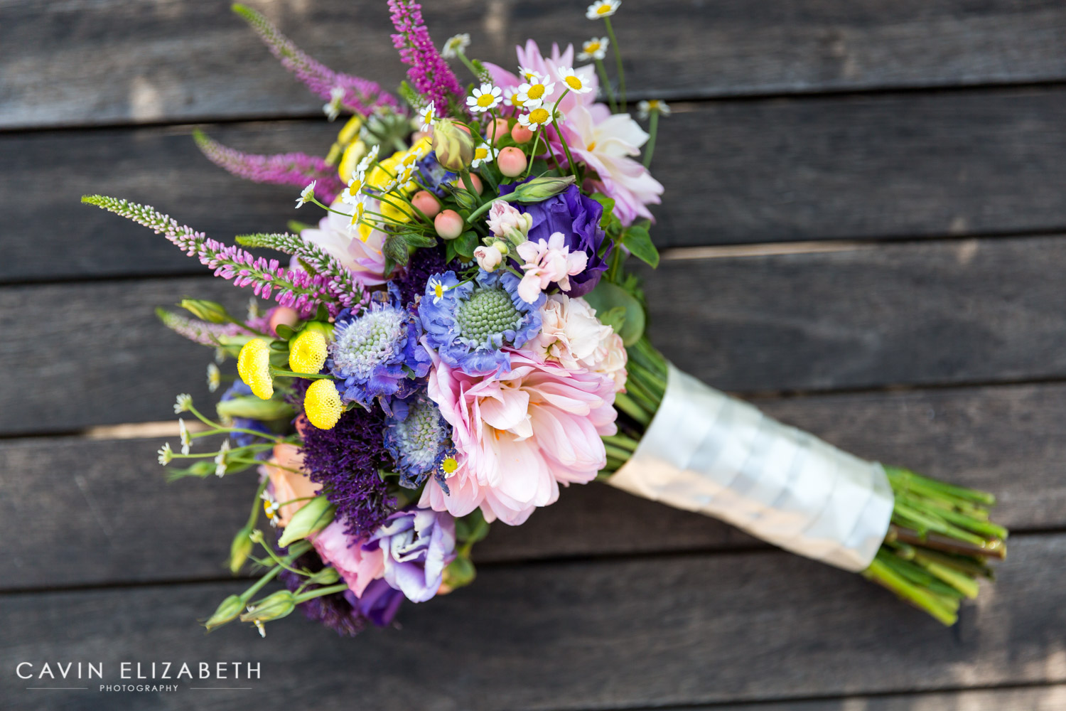 colorful pink purple green and yellow bridal bouquet by whimsey florals
