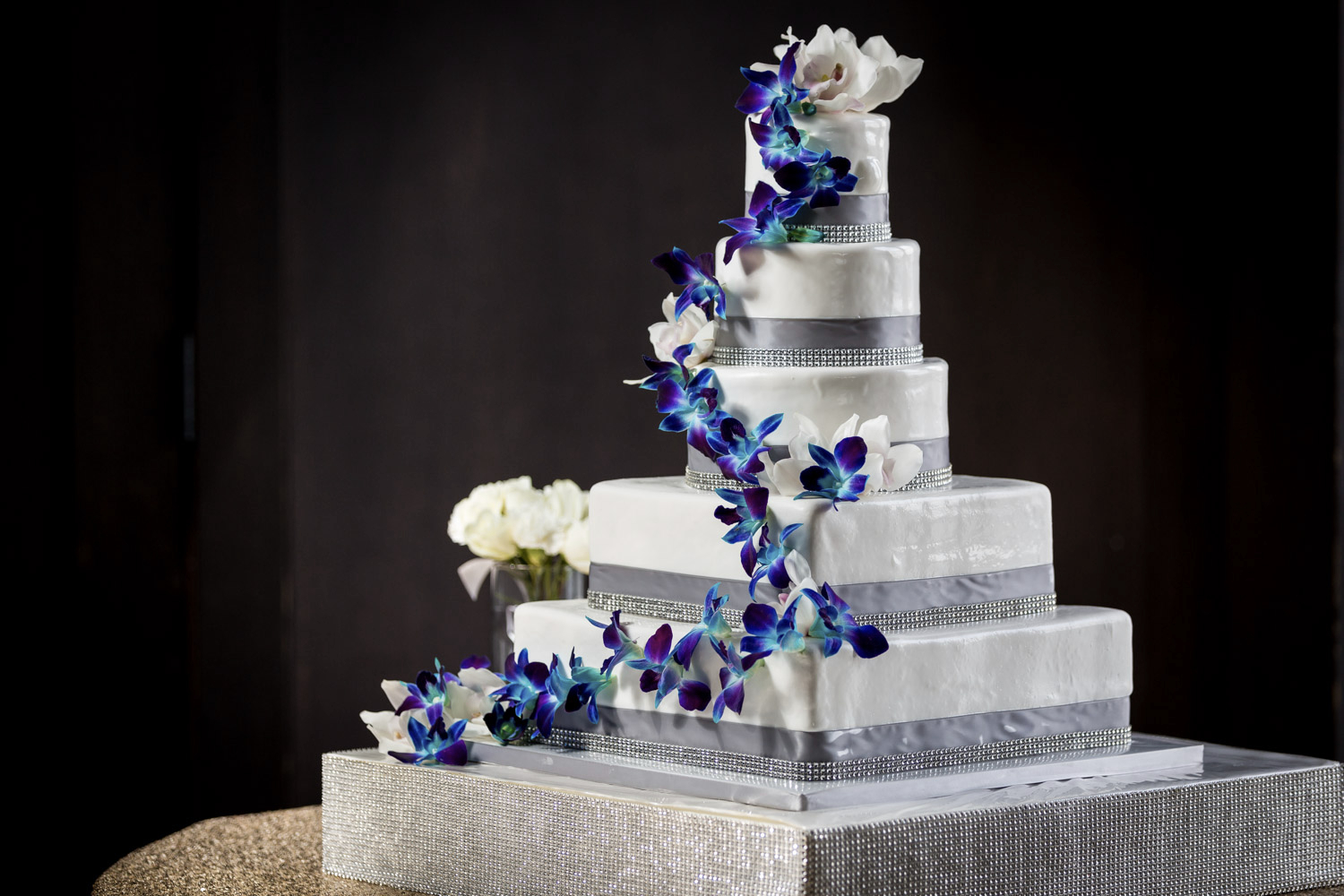 Wonderful Sweet Cheeks 5 Tier White Cake With Grey Ribbon And Blue And Purple  Orchids, Favorite