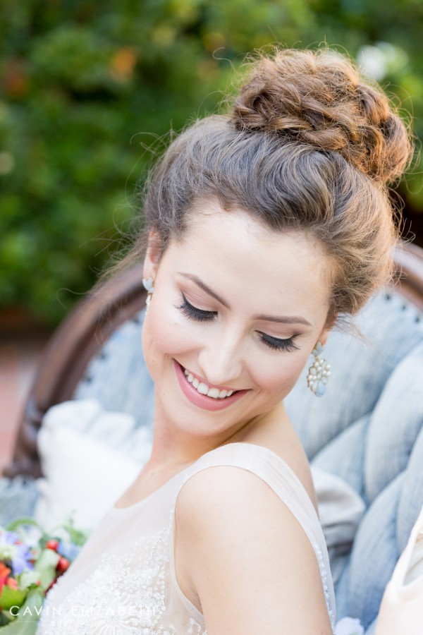 beautiful bridal portrait of a bride with a braided bun, choosing your best wedding hairstyle