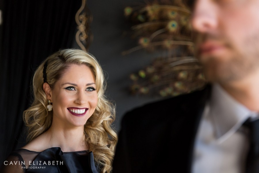 Beautiful candid image of a bride in a black wedding dress with hair and makeup by Unveiled Bridal Beauty in San Diego