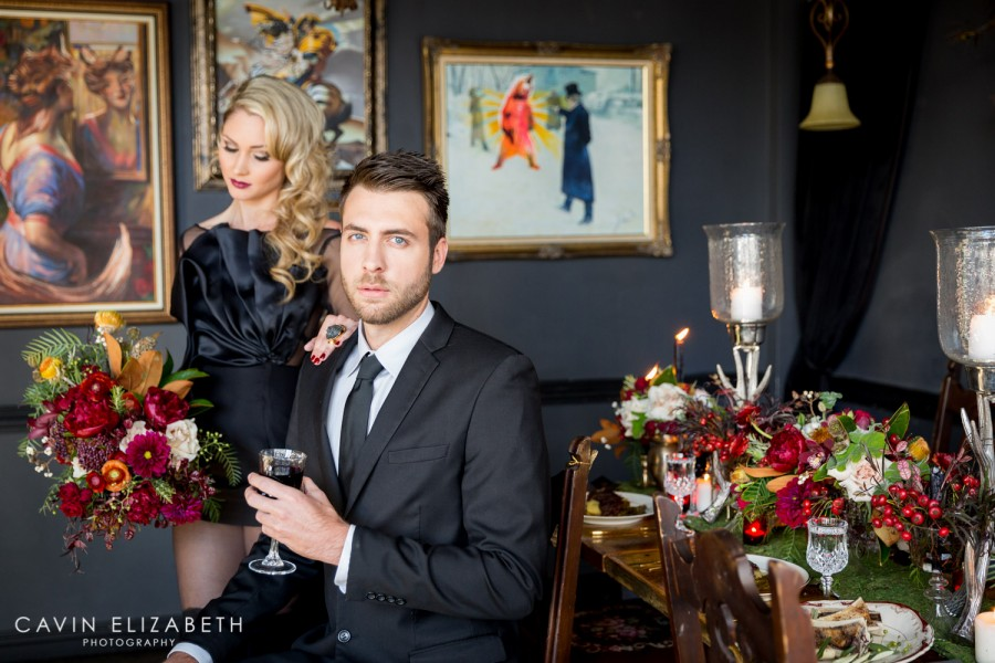 Black couture wedding gown by Paolo Corona Paris with sheer sleeves and a big silk bow for a dark and moody wedding inspiration shoot in San Diego by Cavin Elizabeth Photography, non-traditional luxury bride and groom wearing a black wedding gown
