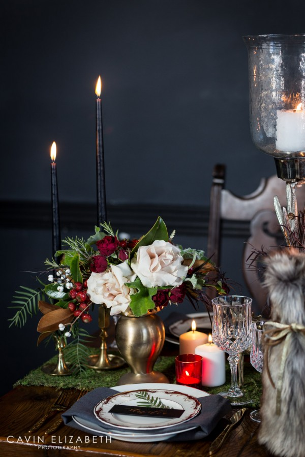 Dark and moody wedding inspiration at Lion's Share in San Diego, Blooms by Breesa Lee white green and red floral arrangement, black candles on a moss table runner