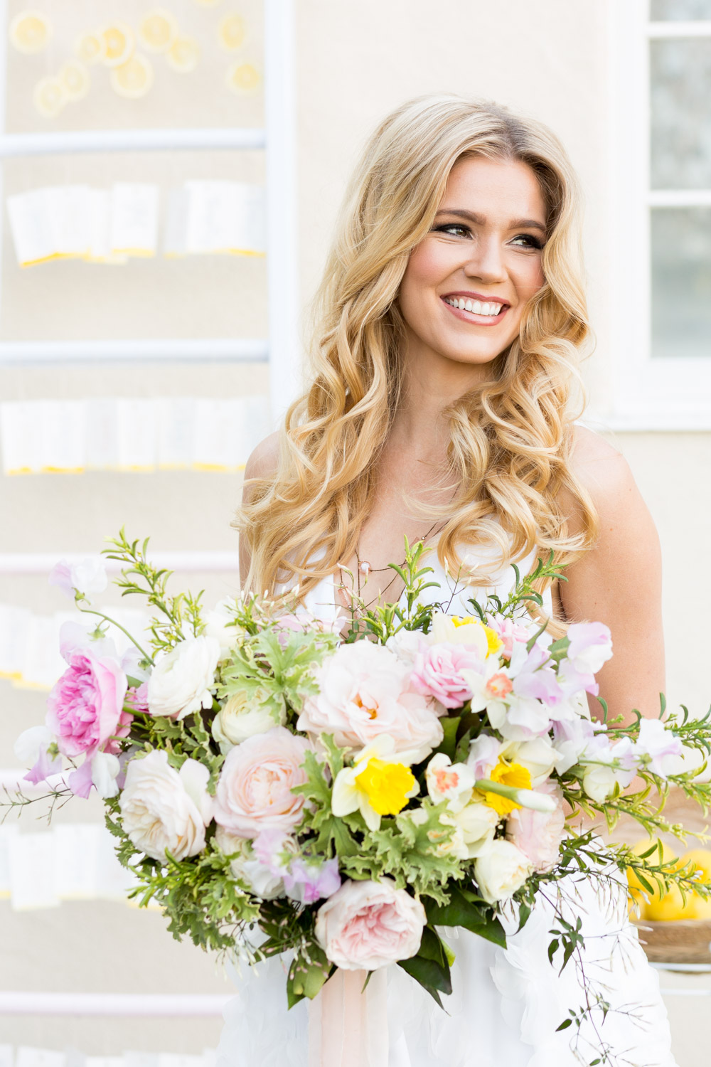 Inn at Rancho Santa Fe wedding bridal portrait of the bride and her large pink yellow and green feminine bouquet