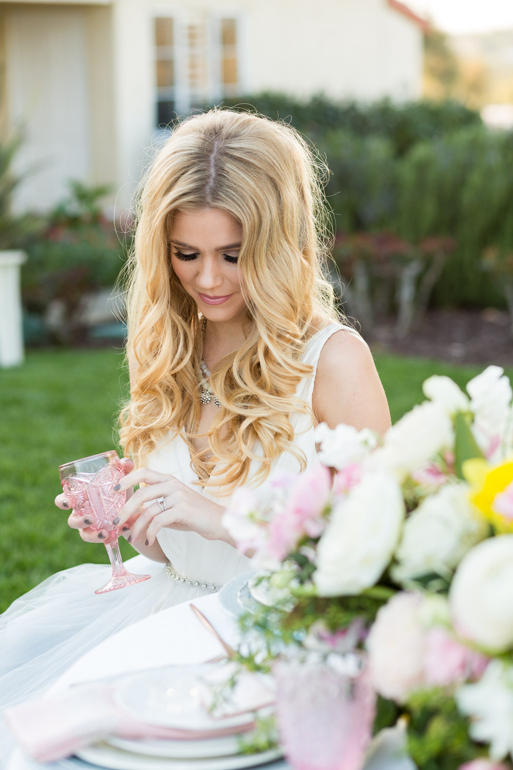 Blonde bridal hair down and curled by Unveiled Beauty