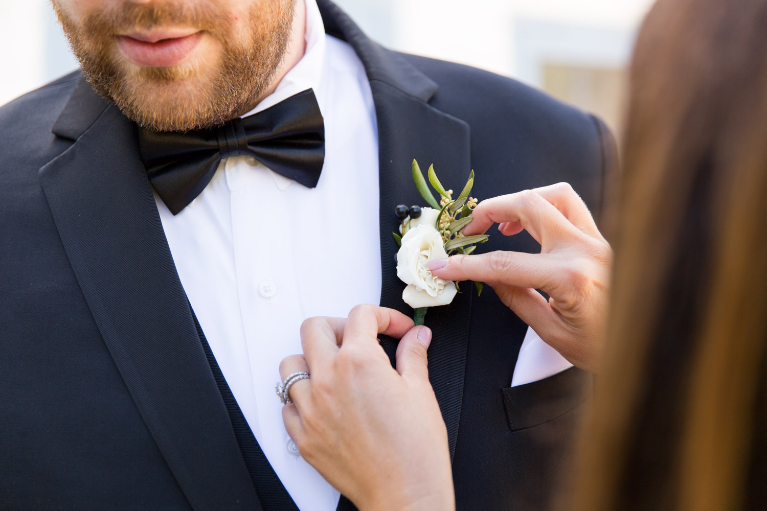 Groom getting his boutonniere on at Leo Carrillo Ranch