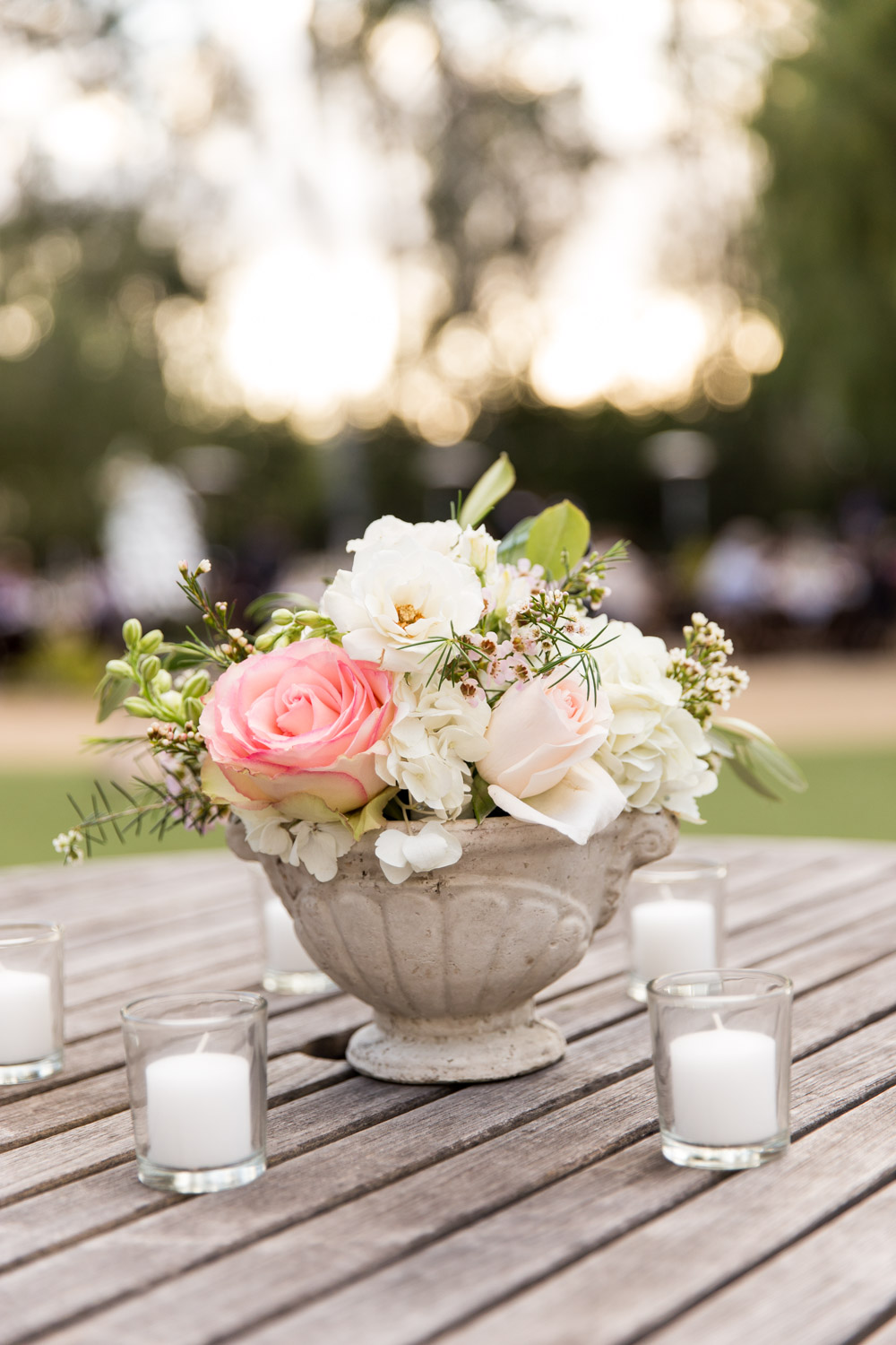 Leo Carrillo Ranch wedding cocktail hour floral arrangement with pink white blush and green