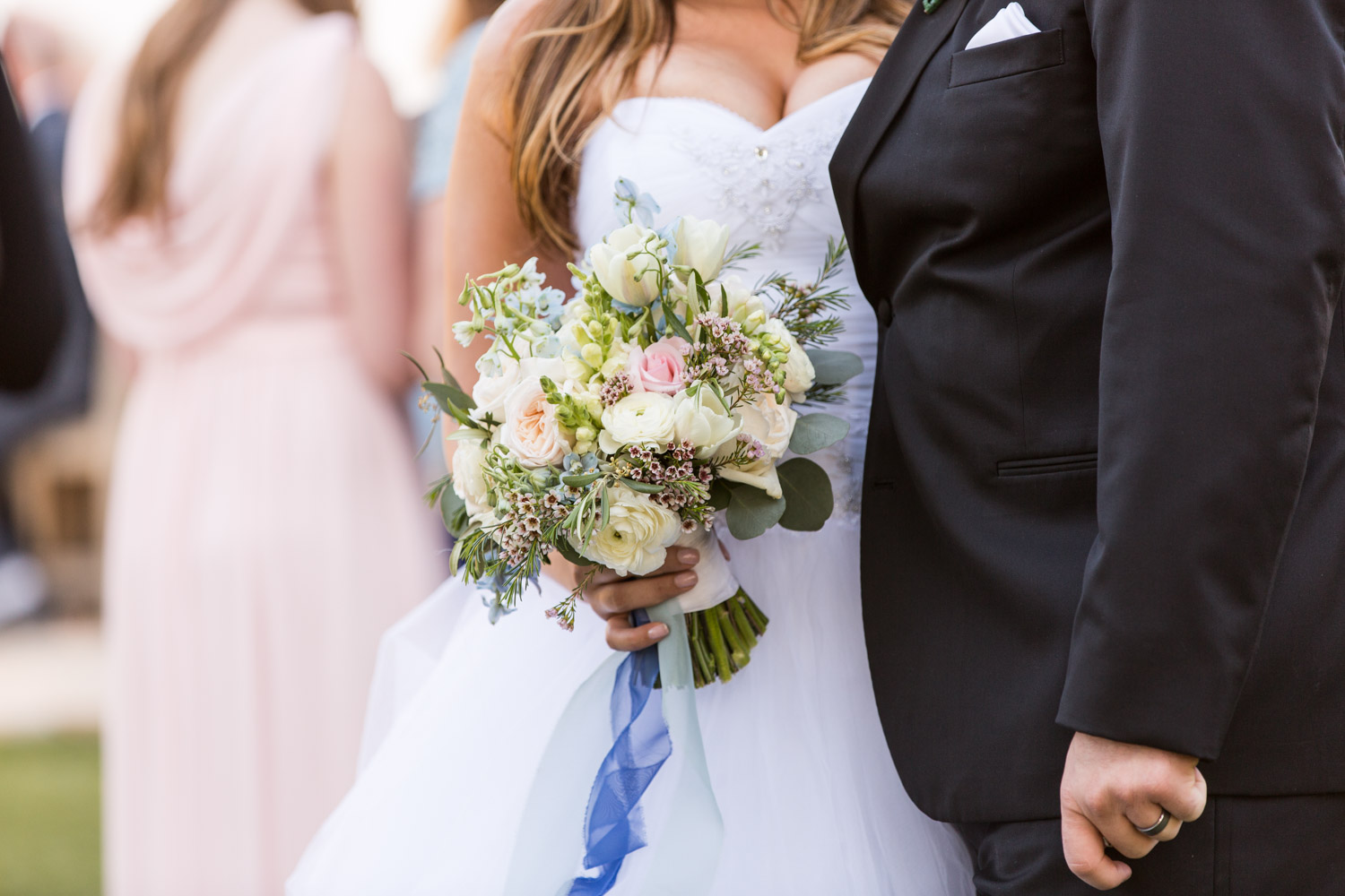 Bride holding Blush blue and green bridal bouquet
