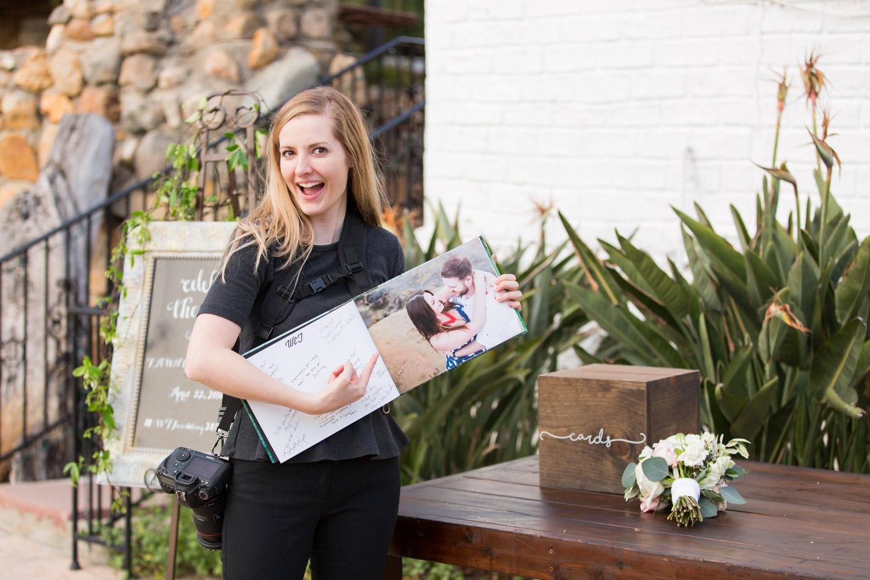 Cavin Elizabeth Photography with a wedding guestbook