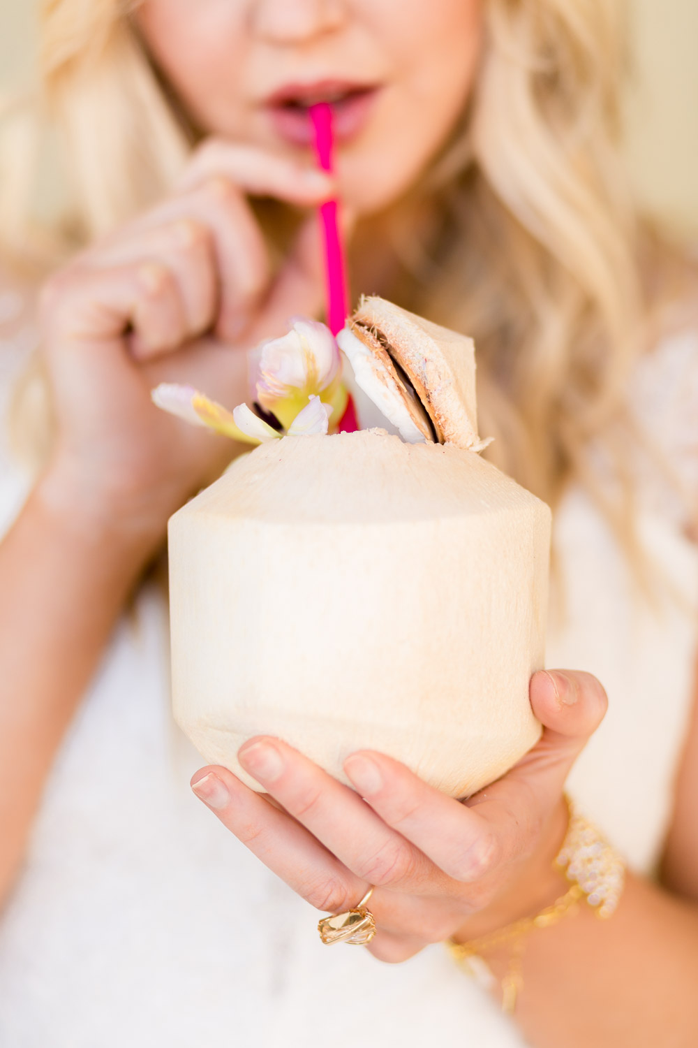 Bride sipping on a coconut for her tropical San Diego wedding