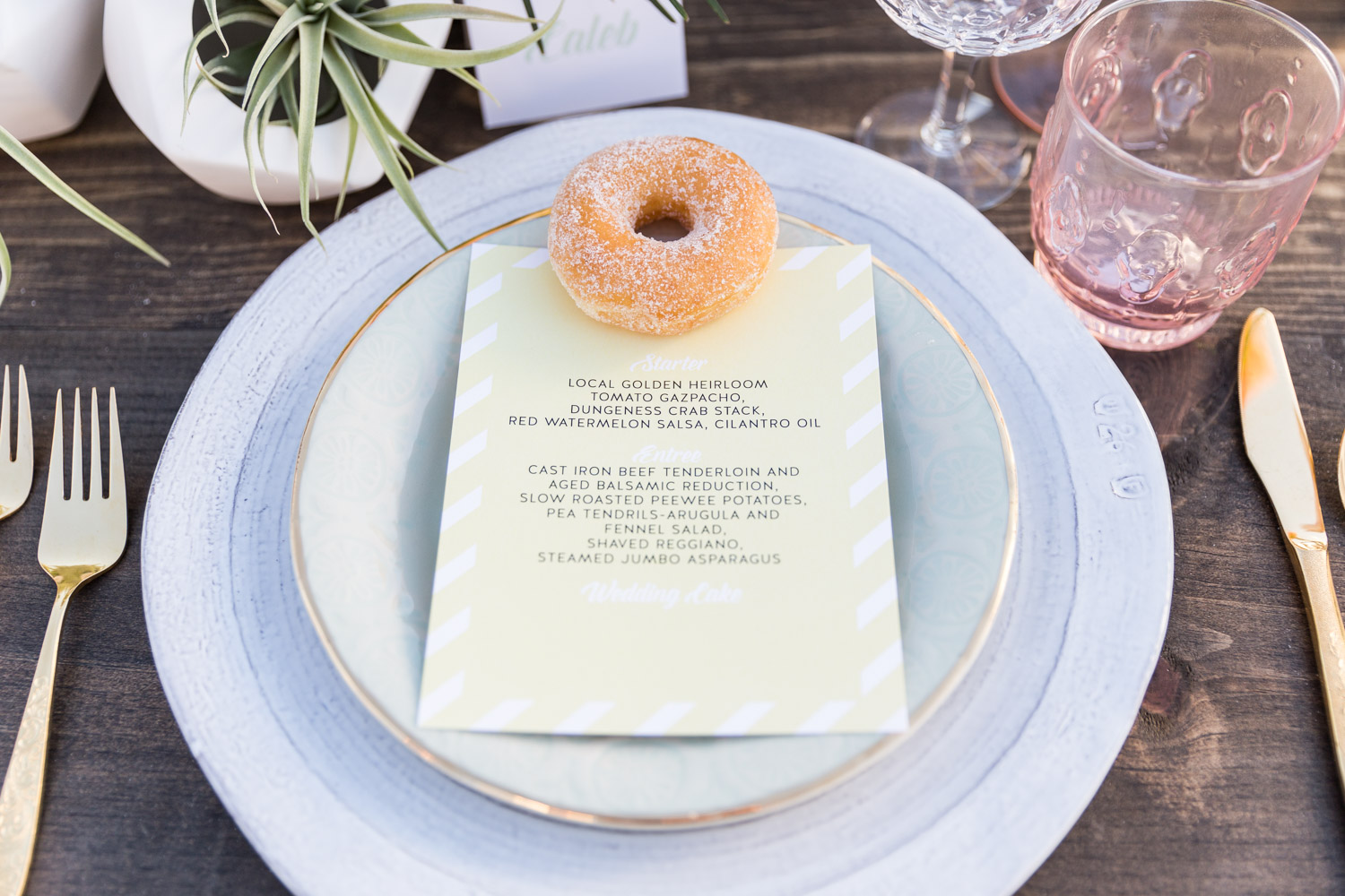 Wedding placesetting with a mini donut and a Posh PAperie menu, Couture Events tropical wedding in Carlsbad