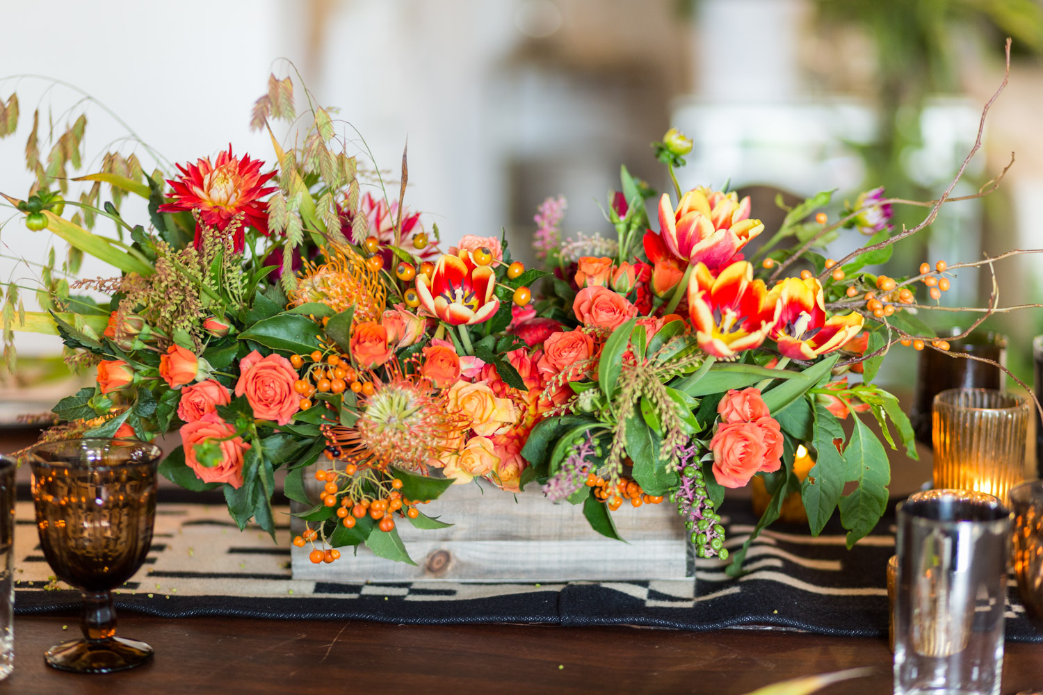 Isari Floral Workshop for a fall tablescape with reds greens yellows and blacks, Cavin Elizabeth Photography