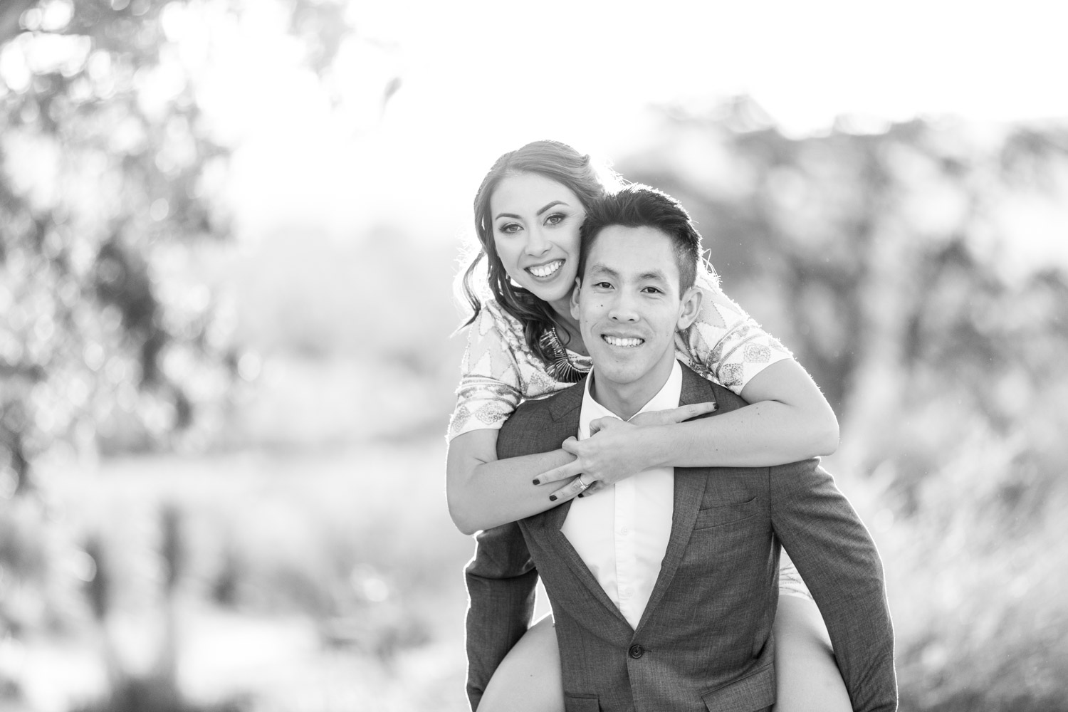 Black and white engagement photo of the groom carrying the bride, Cavin Elizabeth Photography