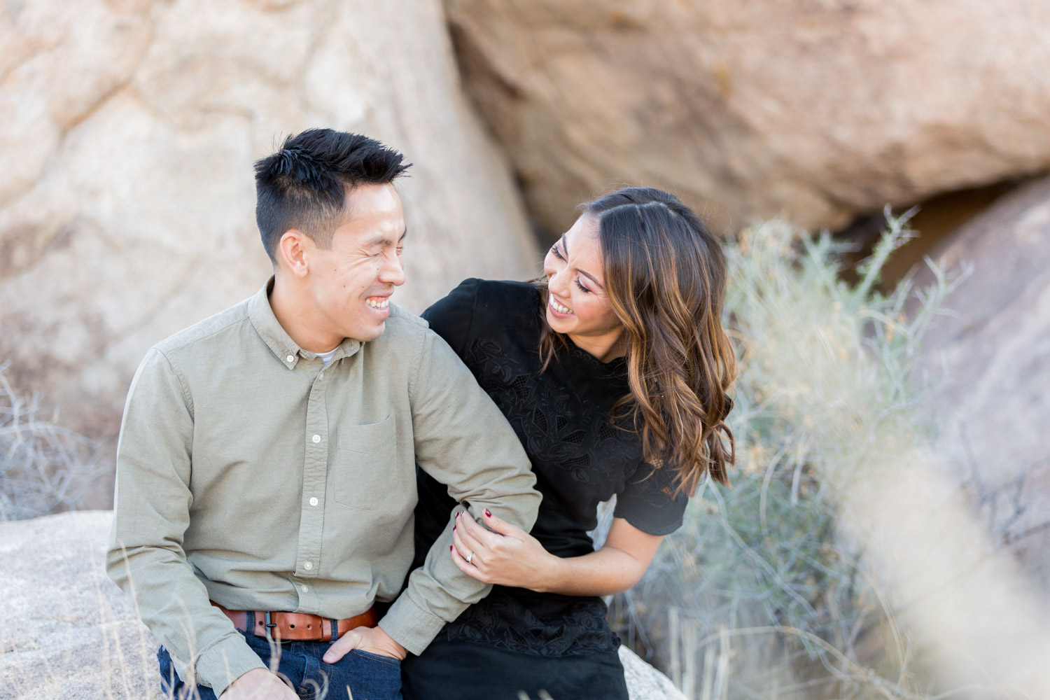 Candid laughing engagement photo of a couple at Joshua Tree
