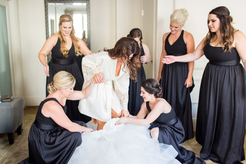 Bride getting into her wedding gown, Cavin Elizabeth Photography