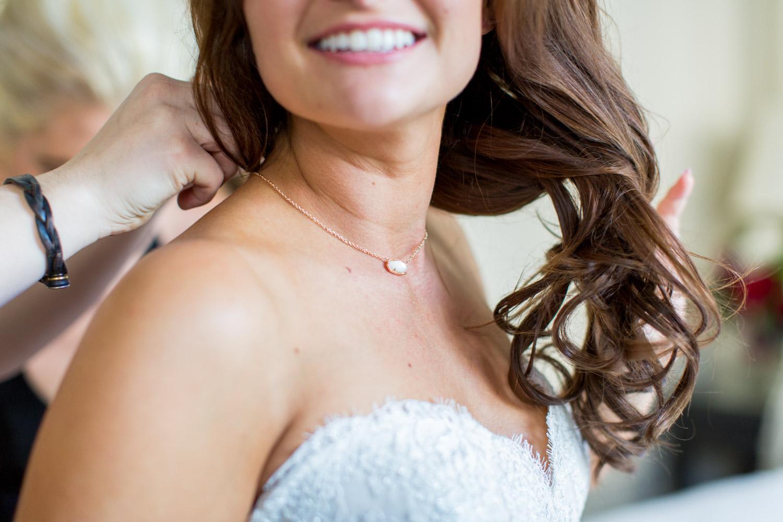 Bride wearing a Kendra Scott necklace, Cavin Elizabeth Photography